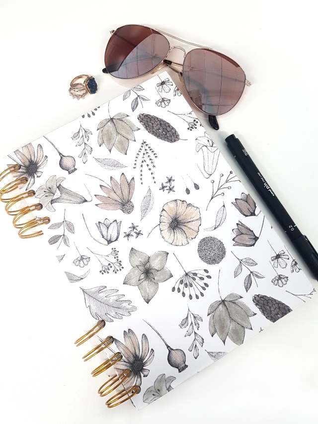 aloma writes beige rose gold notebook pen sunglasses flatlay.jpg