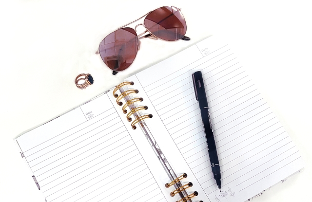 aloma writes beige rose gold open notebook pen sunglasses flatlay.jpg
