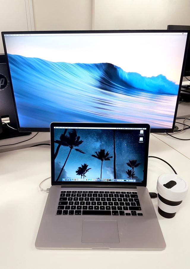aloma writes laptop sceen desk coffee takeaway latte white blue purple pink black silver